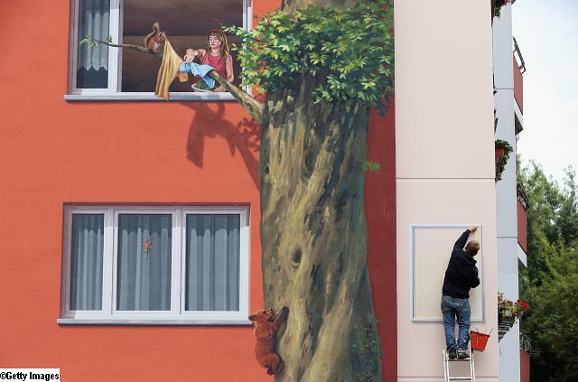 Apartment complex mural by Cite Creation