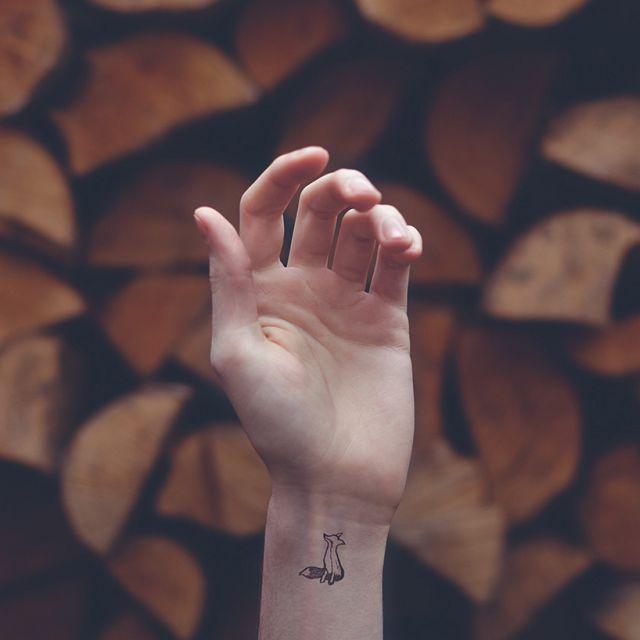 Tiny Tattoo symbolism by Austin Tott